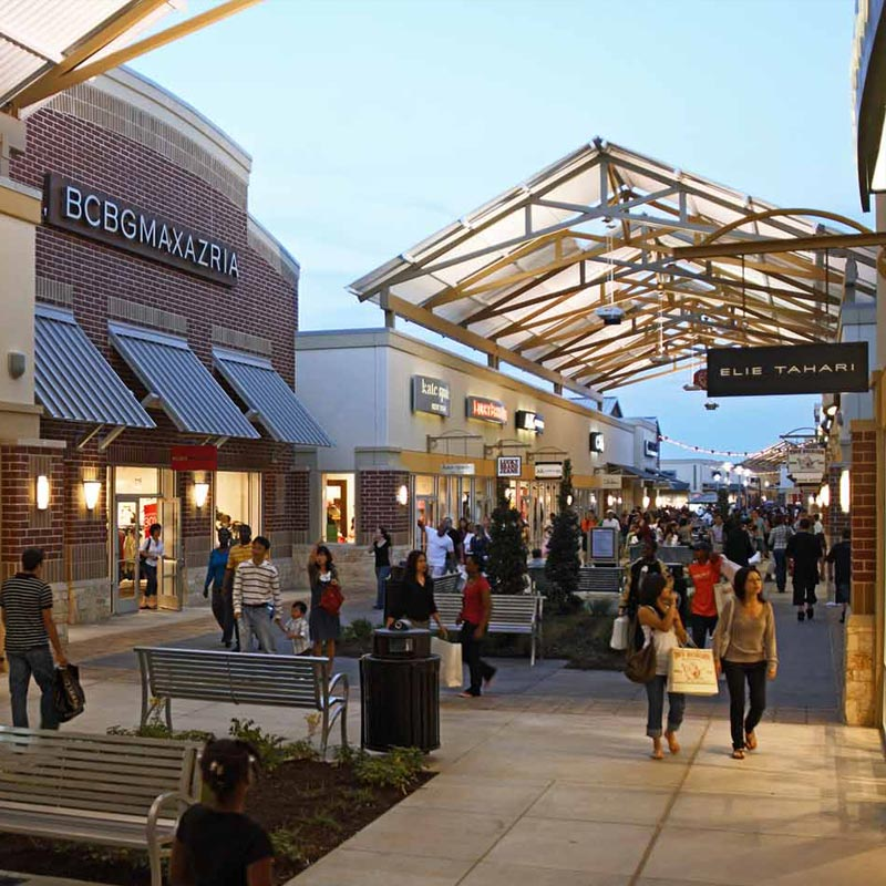 Tanger Outlets - Galveston/Houston Stores and Hours At Tanger, we're committed to bringing you the ultimate shopping experience. For us, that means guiding you towards the best deals at your favorite designer and brand-name stores.